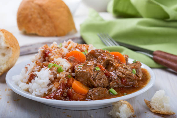 Beef and vegetable casserole Homemade beef and vegetable casserole served with rice on white plate, comfort food for a cold day beef stew stock pictures, royalty-free photos & images