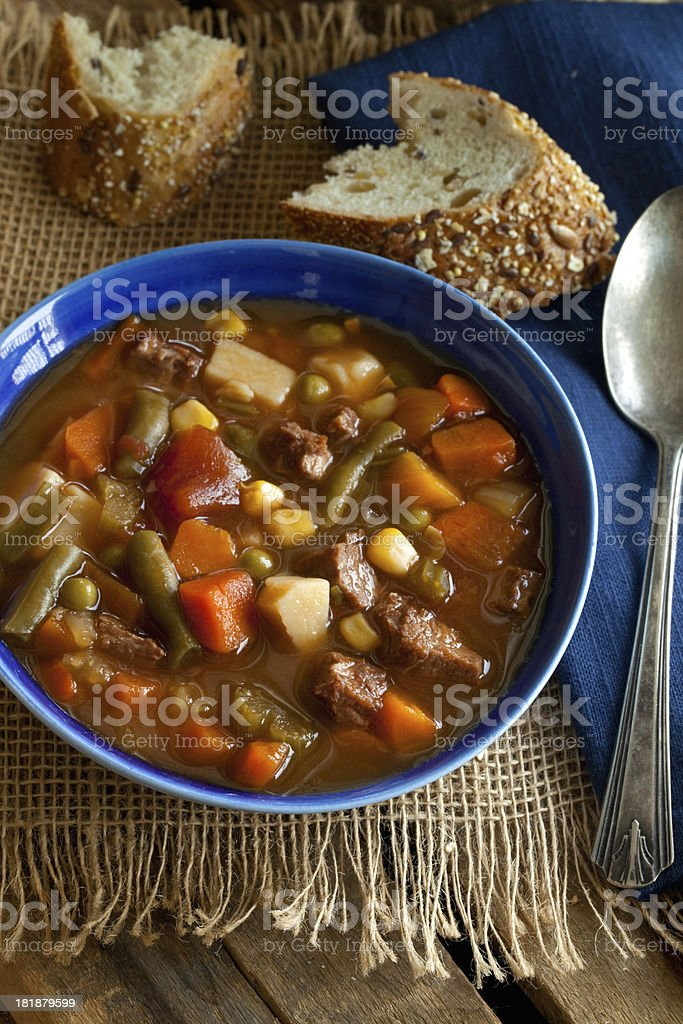 Beef and Vegetable Soup on burlap stock photo