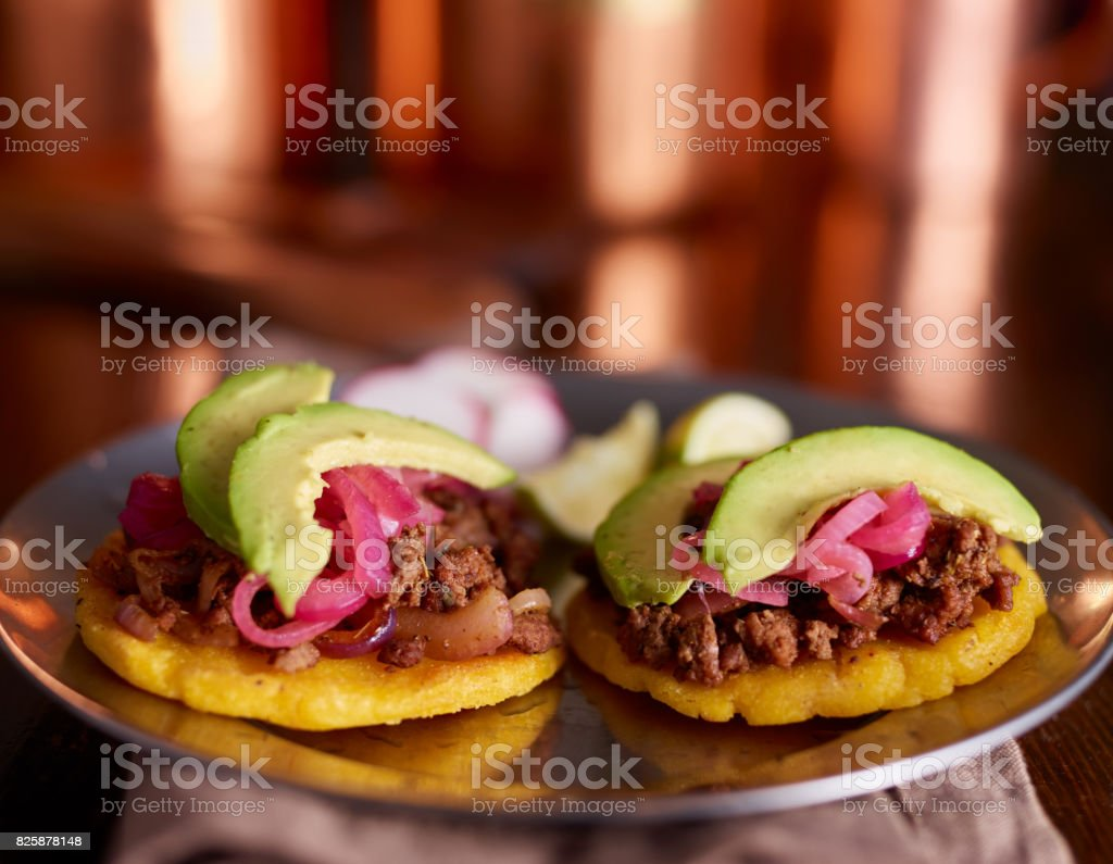 beef arepas with avocado and pickled onion stock photo