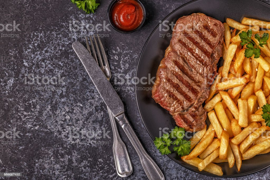 Beef barbecue steak with french fries stock photo