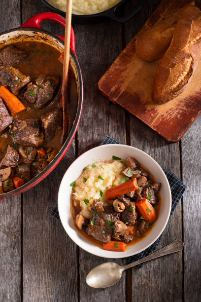 Beef Bourguignon Bowl of Beef Bourguignon with Mashed Potatoes beef bourguignon stock pictures, royalty-free photos & images