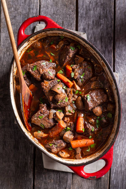 Beef Bourguignon Beef Bourguignon in an Enameled Cast Iron Dutch Oven stew stock pictures, royalty-free photos & images