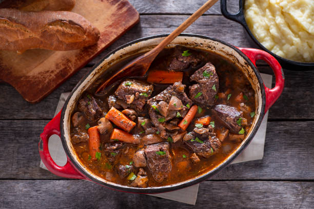 Beef Bourguignon Beef Bourguignon in an Enameled Cast Iron Dutch Oven beef bourguignon stock pictures, royalty-free photos & images