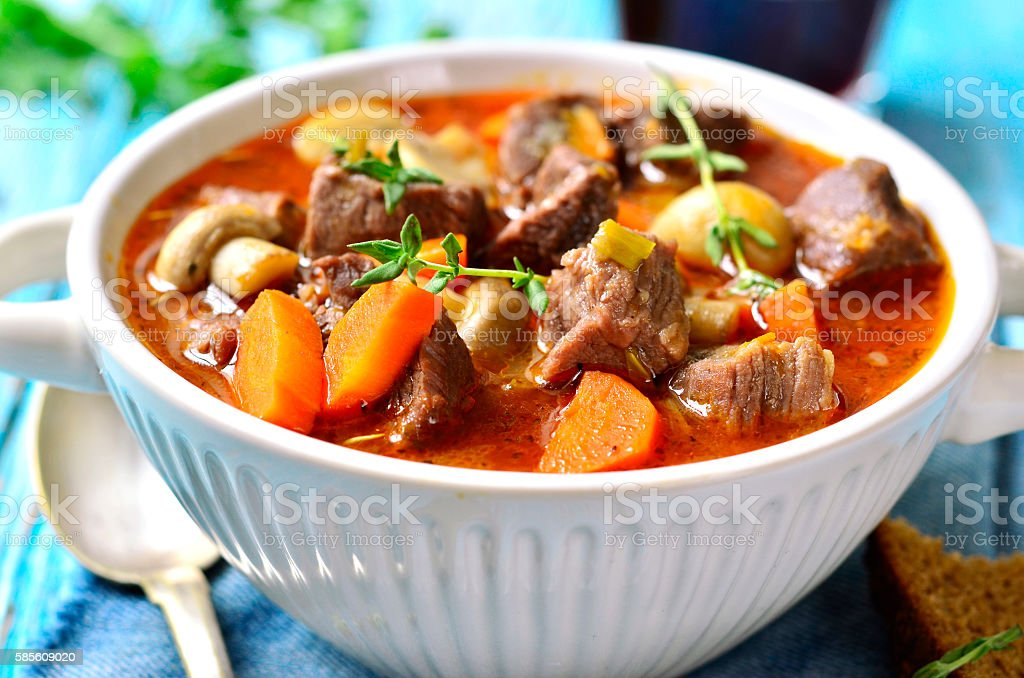 Beef Bourguignon. Beef Bourguignon in rustic bowl on turquoise wooden table. Alcohol - Drink Stock Photo