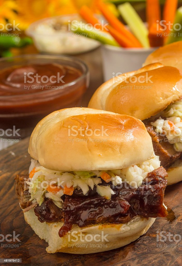 beef brisket sliders smothered in BBQ sauce stock photo