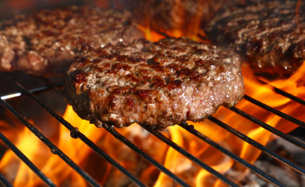 Beef burger for hamburger on barbecue flame grill stock photo