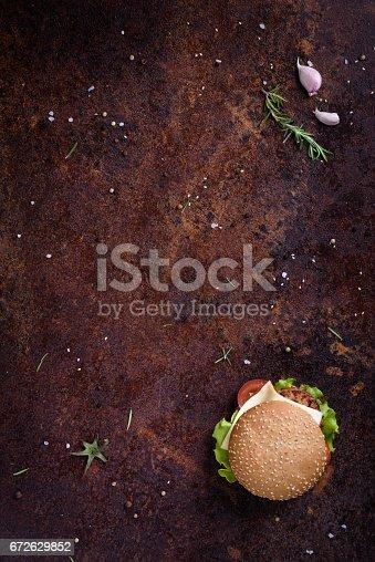 istock Beef burger in a sesame bun. Restaurant menu frame, mock up. 672629852