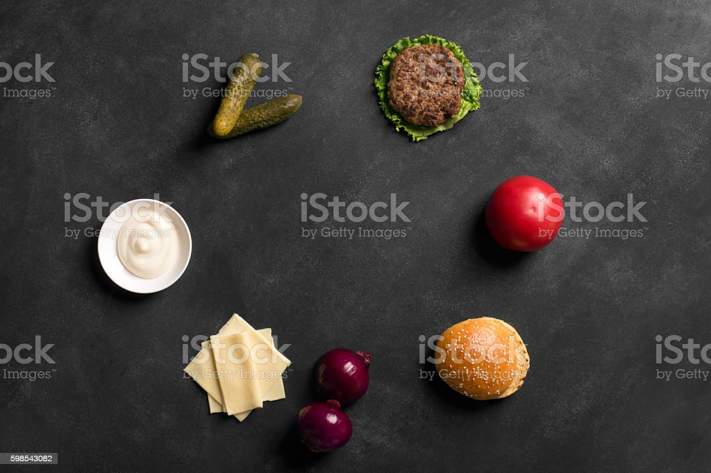 Beef burger with lettuce and sauce on the black chalkboard photo libre de droits