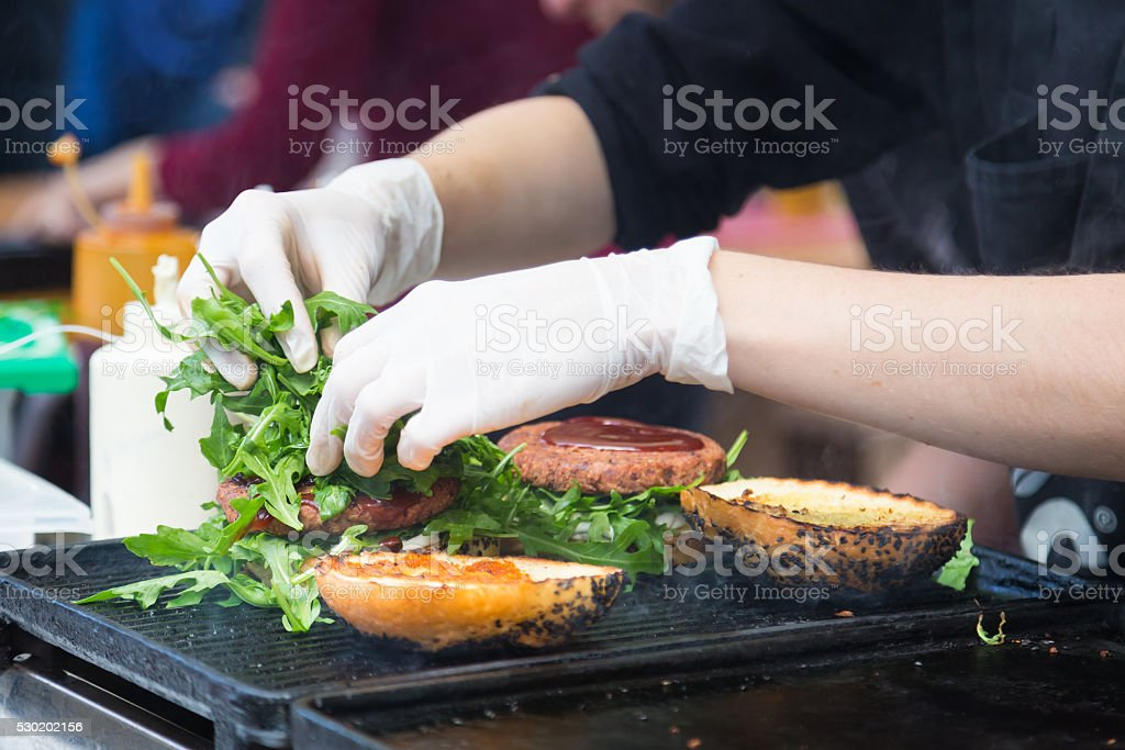 Beef burgers ready to serve on food stall. stock photo