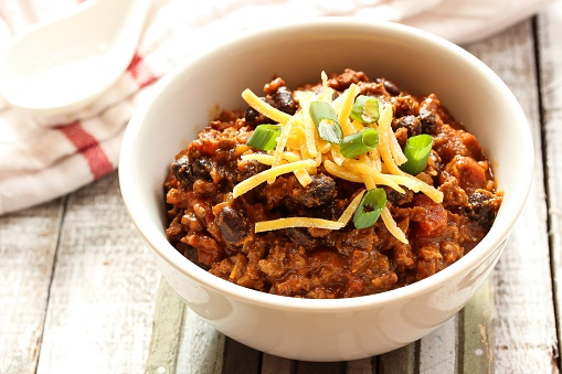 Beef Chili With Kidney Beans And Cheese Topping Stock Photo - Download Image Now