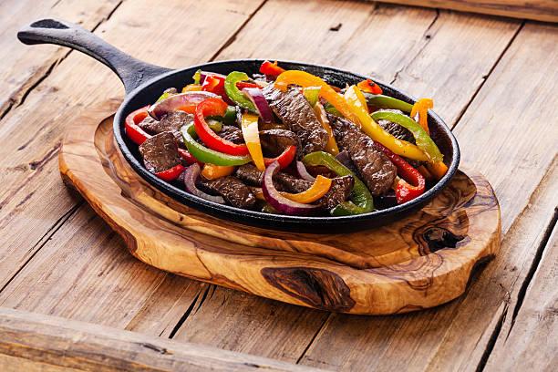 Beef Fajitas in pan stock photo