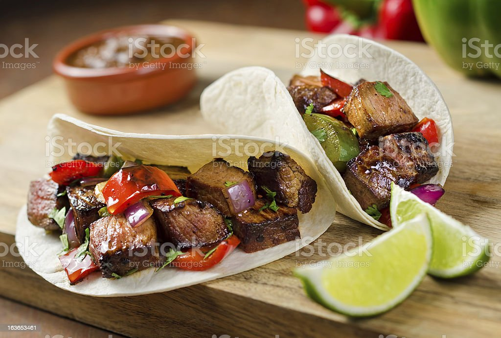 Beef fajitas with sauce and lime on the side stock photo
