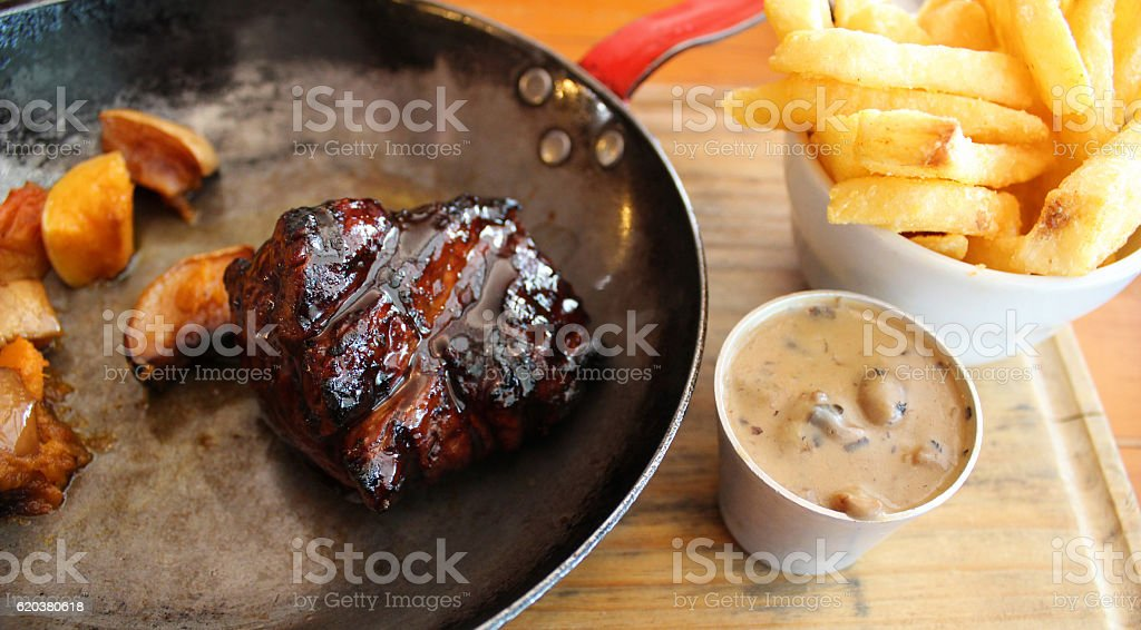 Beef fillet, chips and peppercorn sauce stock photo