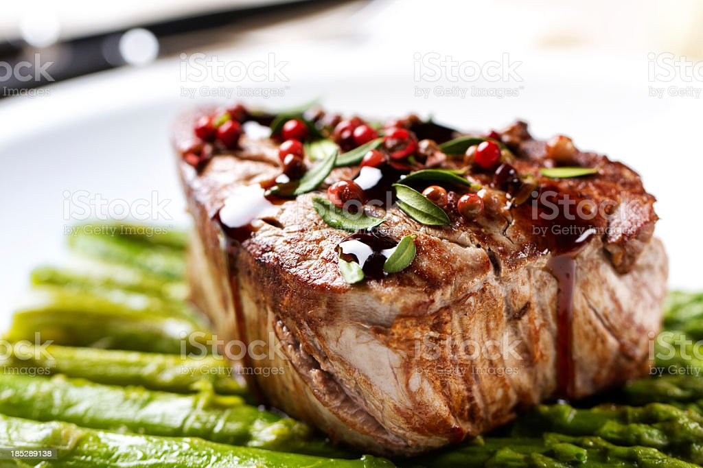 Beef fillet with pink pepper and asparagus stock photo