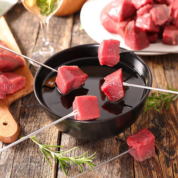 beef fondue - fondue zutaten stock-fotos und bilder