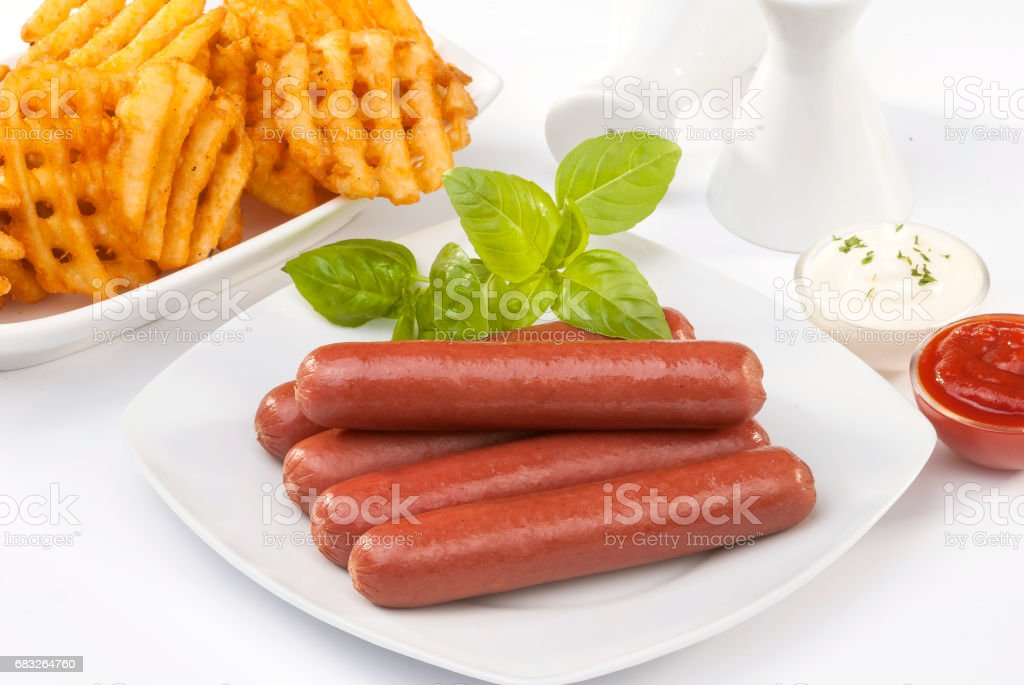 beef franks with mayonnaise ketchup and fries royalty-free stock photo
