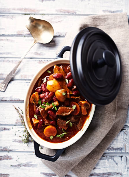 Beef goulash with mushrooms and vegetables Beef goulash with mushrooms and vegetables goulash stock pictures, royalty-free photos & images
