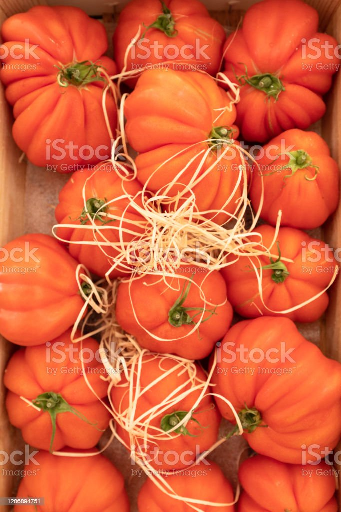 beef heart tomatoes Tomatoes in a vertical crates. Agriculture Stock Photo