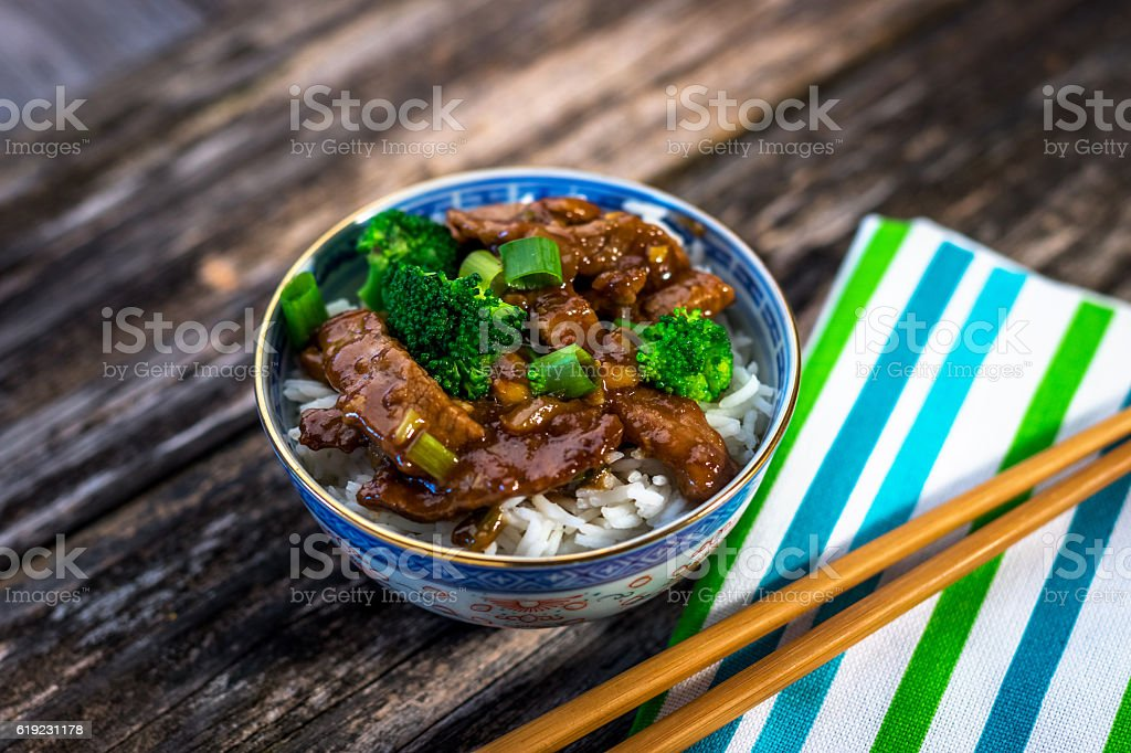 Beef in sauce with broccoli and rice stock photo