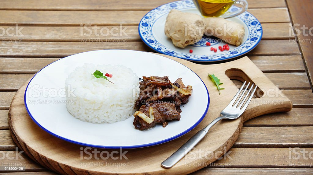 beef in spicy sauce and rice with celeriac and ginger stock photo