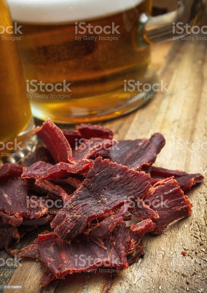 Beef Jerky and Beer stock photo