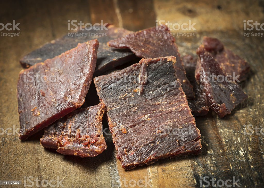 Beef Jerky on a cutting board stock photo
