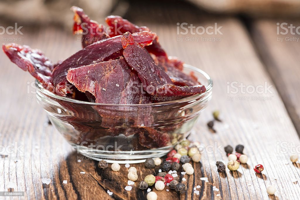 Beef Jerky on wooden background stock photo