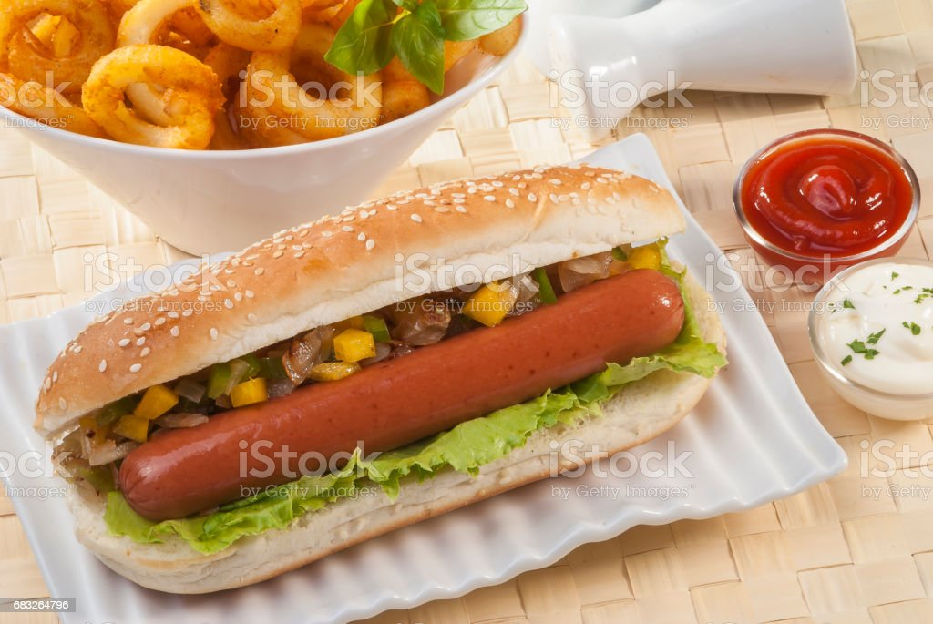 Beef Jumbo sausage sandwich with coleslaw & Ketchup & Fries royalty-free stock photo
