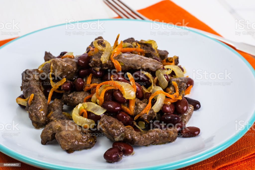 Beef liver, onions, carrots fried stock photo