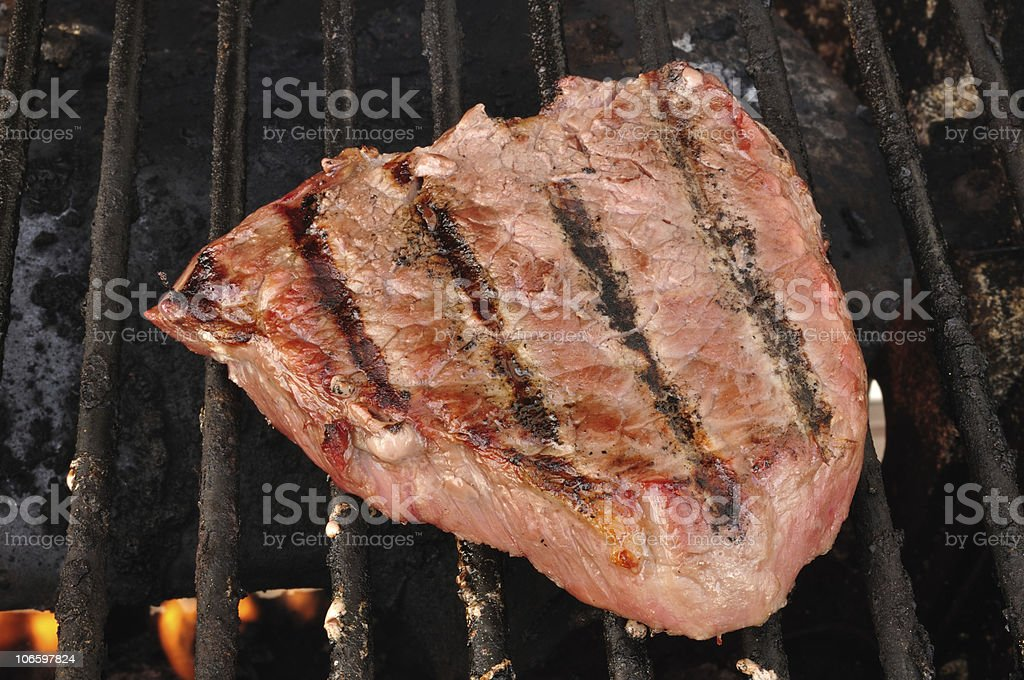 Beef Loin Top Sirloin Steak on the Grill royalty-free stock photo