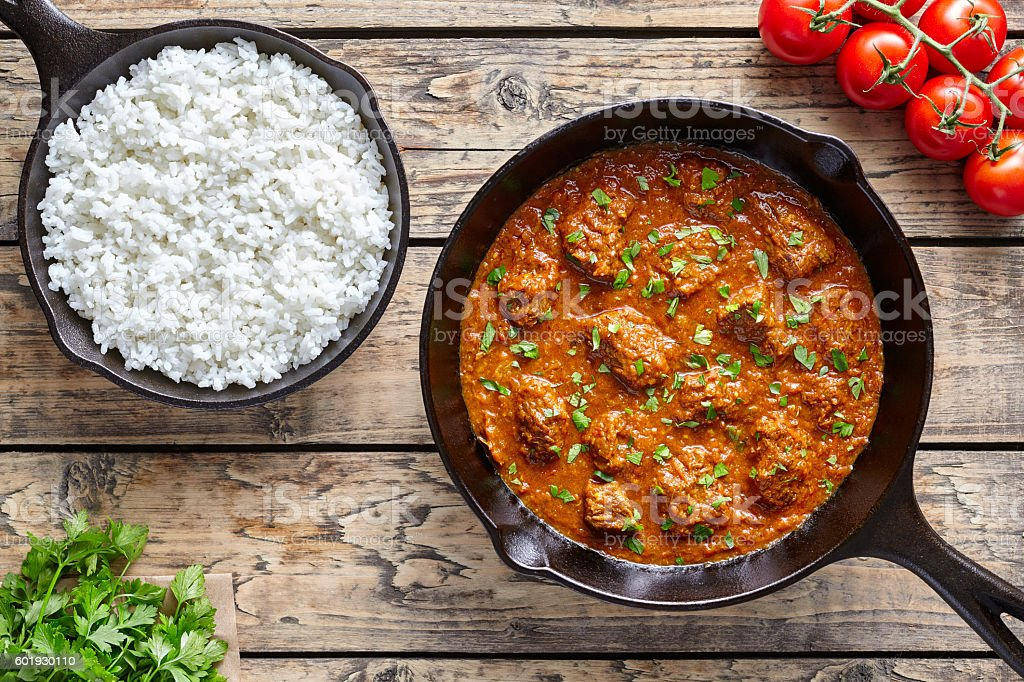 Beef Madras curry slow cook Indian spicy garam masala lamb stock photo
