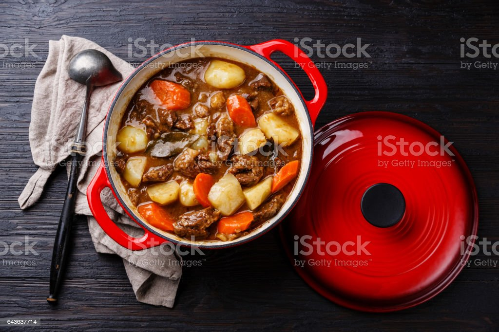 Beef meat stew pot with potatoes, carrots and spices stock photo