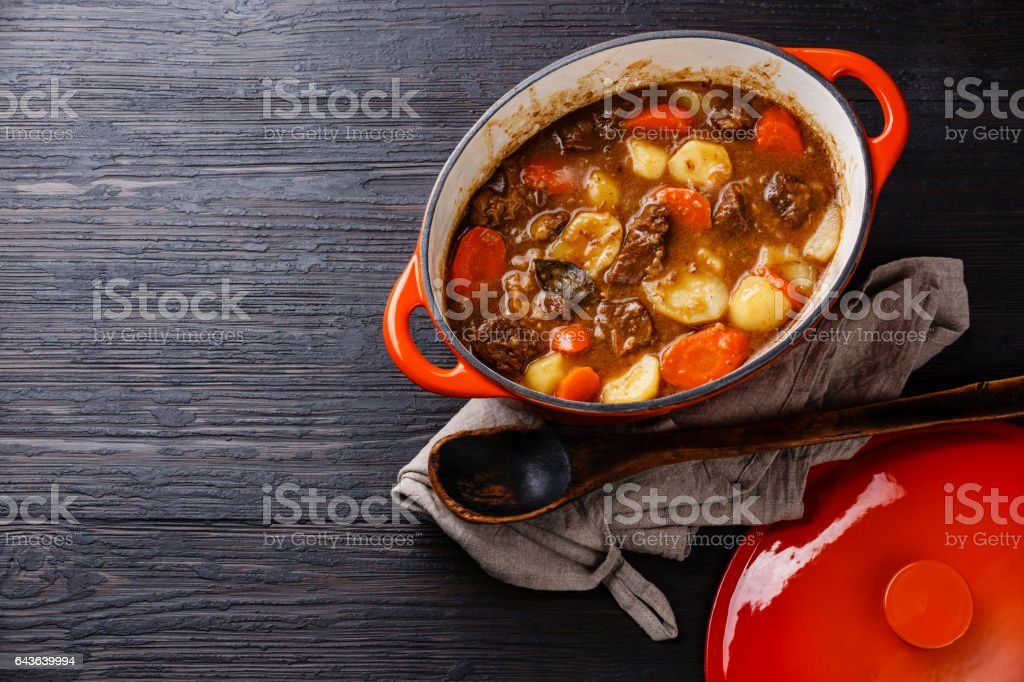 Beef meat stew with potatoes, carrots and spices stock photo