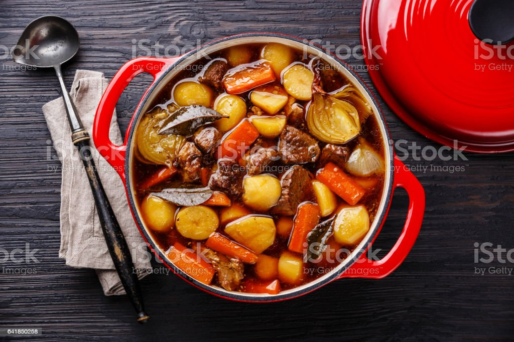 Beef meat stewed with potatoes, carrots and spices stock photo