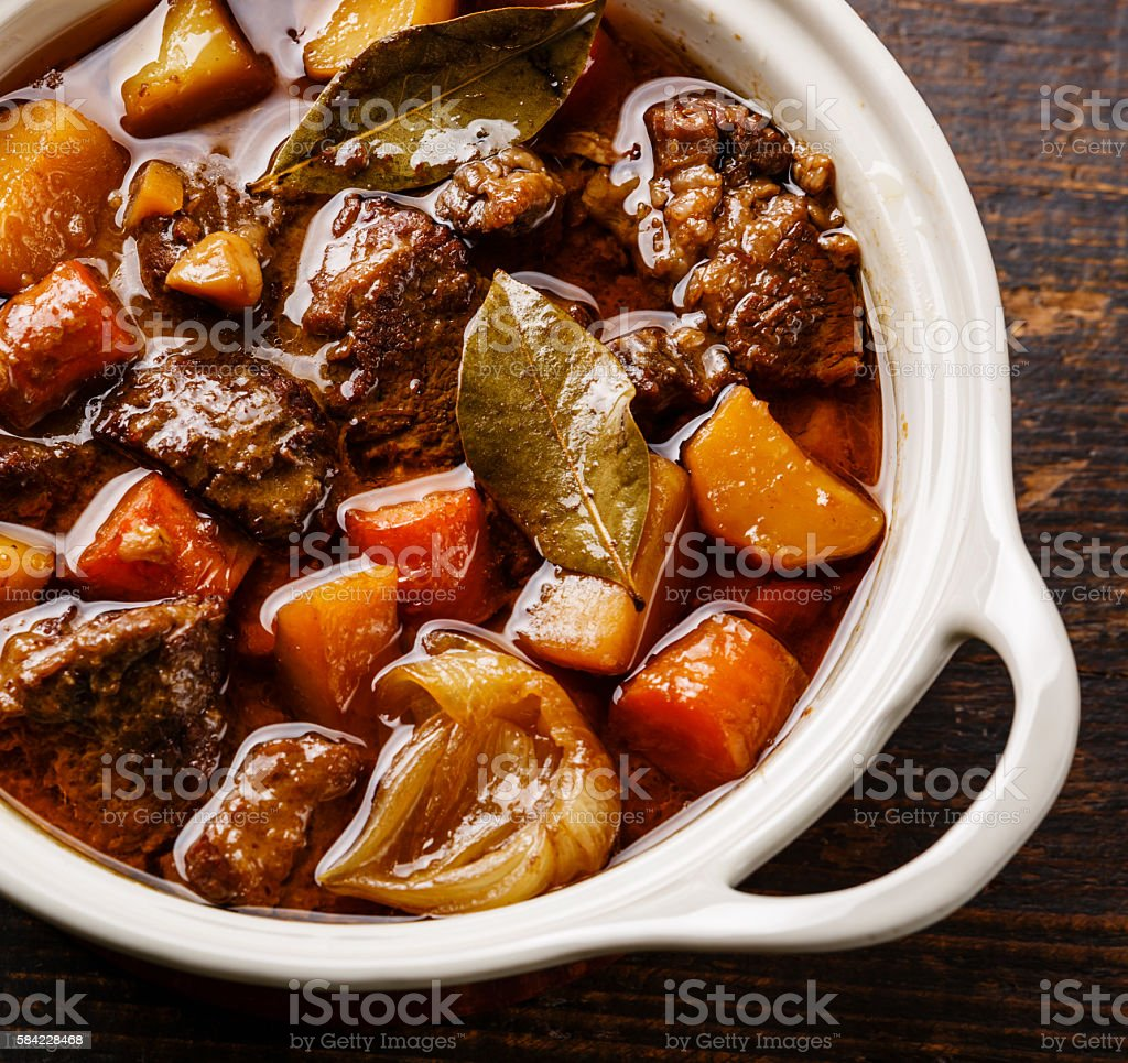 Beef meat stewed with potatoes close up stock photo
