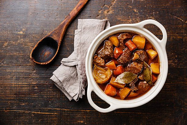 Beef meat stewed with potatoes stock photo