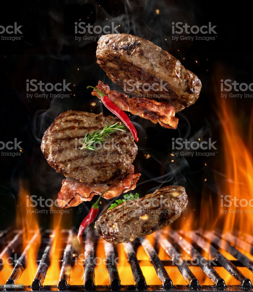 Beef milled meat flying above grill stock photo