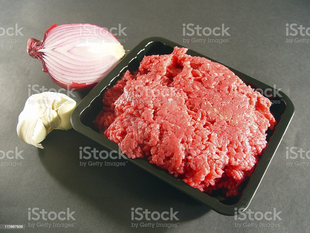 Beef, onion half, garlic royalty-free stock photo