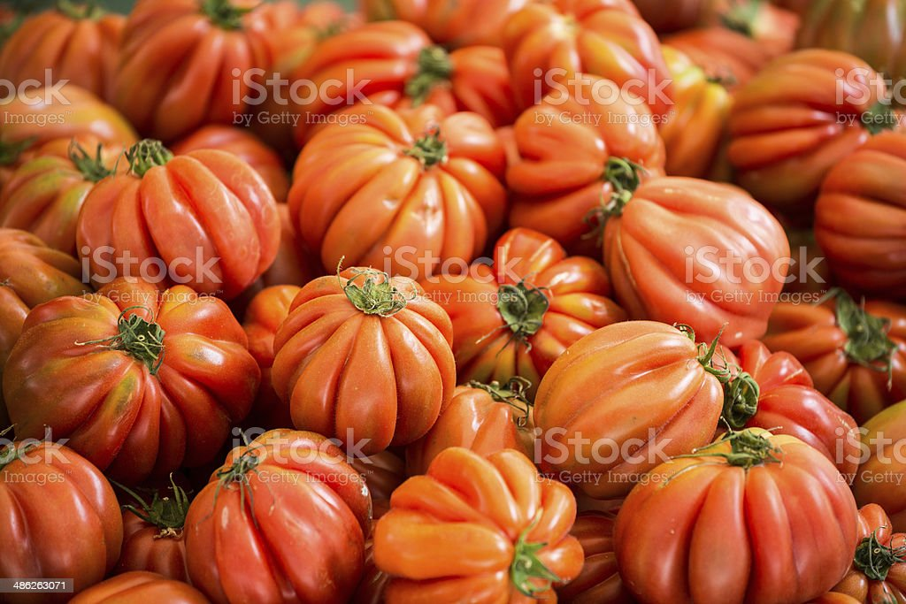 Beef or beefsteak tomato in street market stock photo