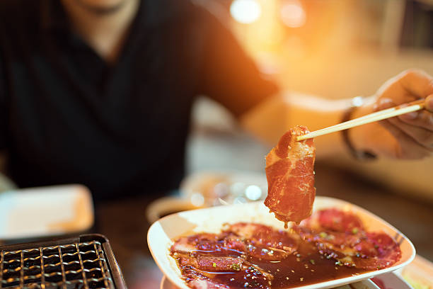 beef or pork slice, charcoal grill, yakiniku japanese style barbecue - 韓国文化 ストックフォトと画像