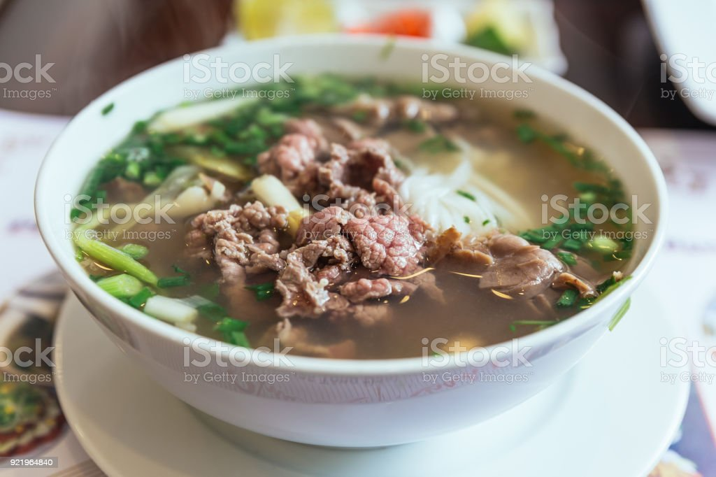 Beef Pho is a Vietnamese soup consisting of broth, rice noodles called bánh phở, a few herbs, and meat, primarily made with either beef or chicken. stock photo