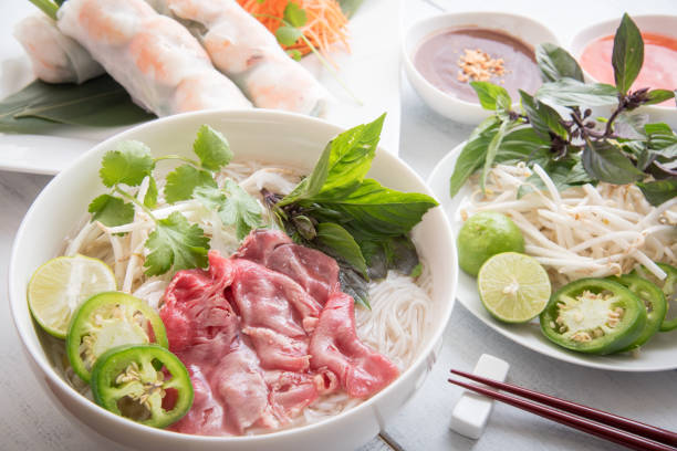 beef pho with summer roll - pho soup stock photos and pictures