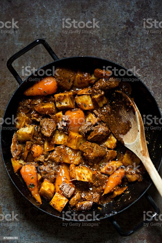 Beef red wine casserole with roasted potatoes, carrots, mushrooms stock photo