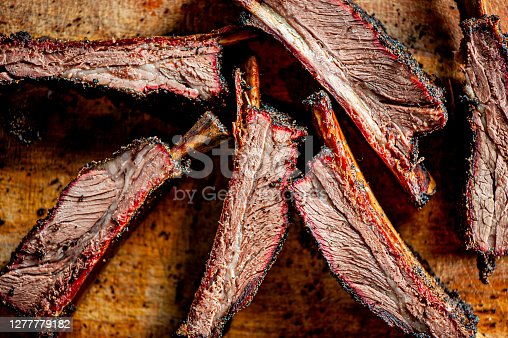 istock Beef ribs. Barbecue table spread. Beef brisket, chicken, pork ribs, beef ribs, Mac n cheese, cornbread, Brussels sprouts, coleslaw & beer. Classic traditional Texas meats & side dishes. 1277779182
