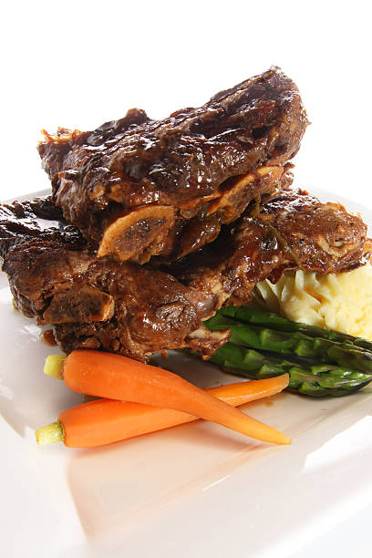 beef ribs - braised stock pictures, royalty-free photos & images