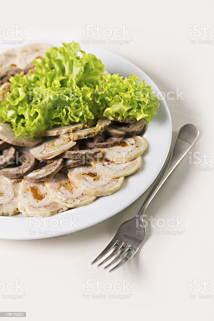 beef roll with dried apricots and salad closeup royalty-free stock photo