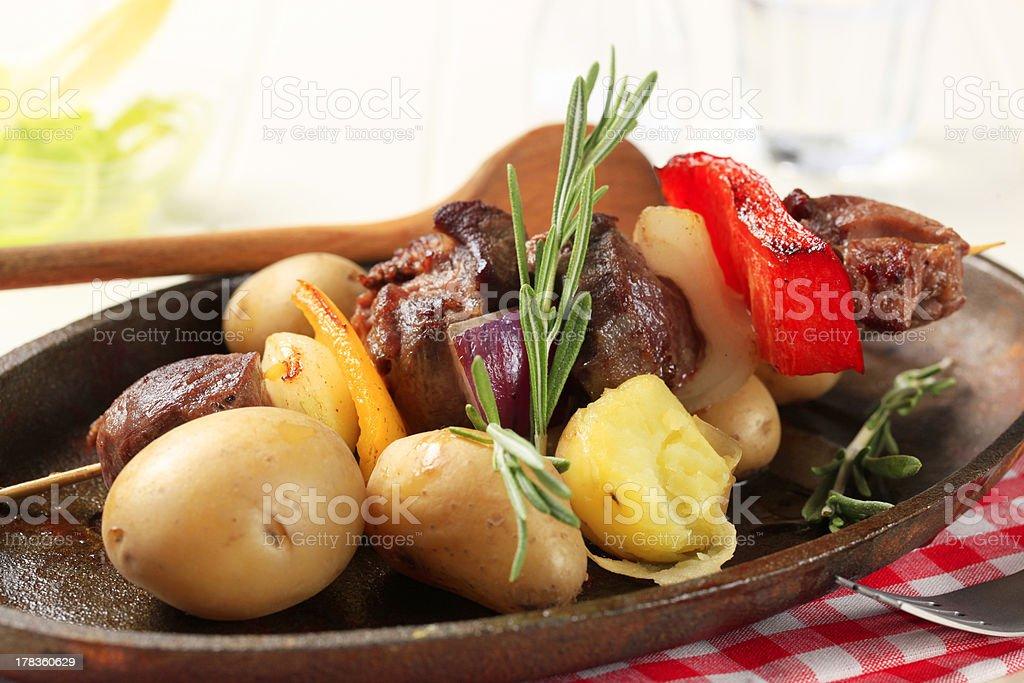 Beef shish kebab and new potatoes royalty-free stock photo