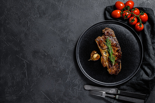 istock Beef sirloin steak on black background. Space for text. Marble beef. 1188271838