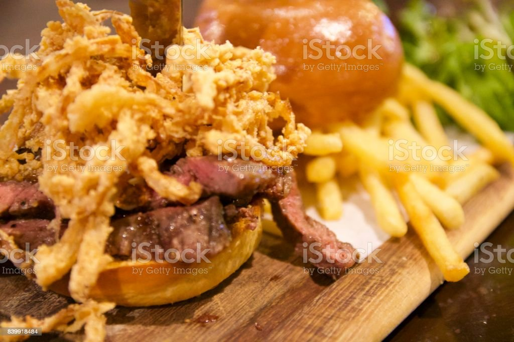 Beef slice burger with savoury blue cheese and fried onions stock photo