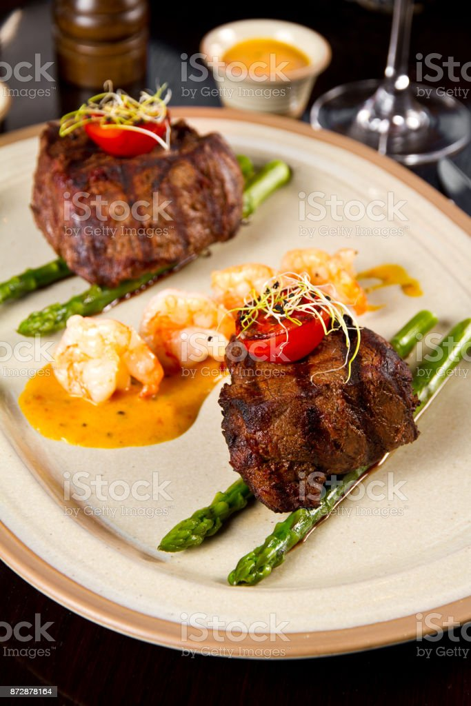 Beef steak and shrimp with grilled vegetables stock photo